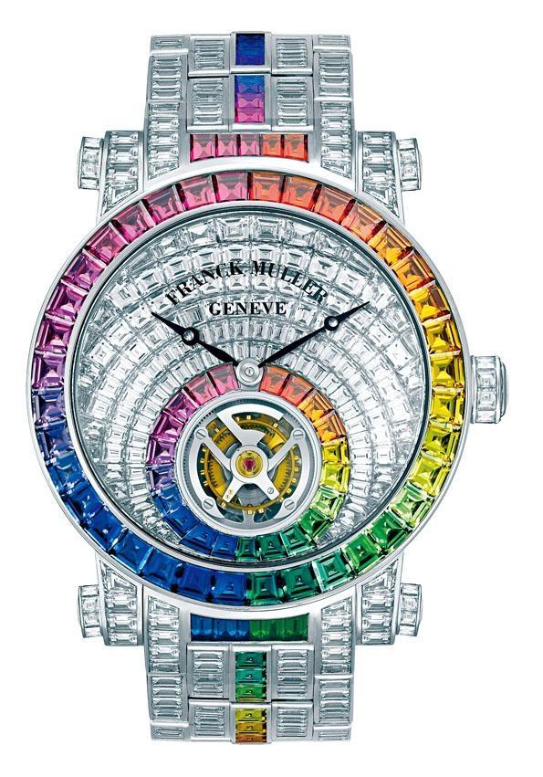 ●Franck Muller最新Rainbow Invisible Setting陀飛輪,採用最頂尖的隱密式鑲嵌工藝,單是表面已鑲嵌了122顆長方形鑽石,共7.99卡,配合共2.48卡的21粒長方形彩色藍寶石,六時位置是品牌著名的FM字形陀飛輪。此表紅色版為足球明星C.朗拿度擁有,售價$10,560,000。