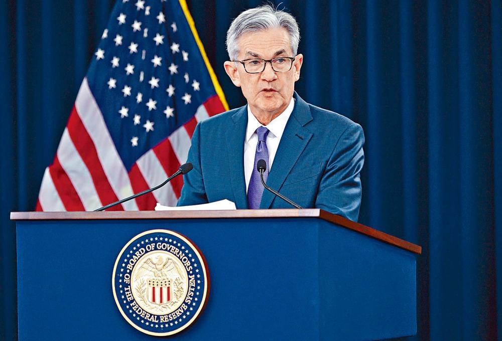 美國聯儲局減息四分一厘,圖為主席鮑威爾。