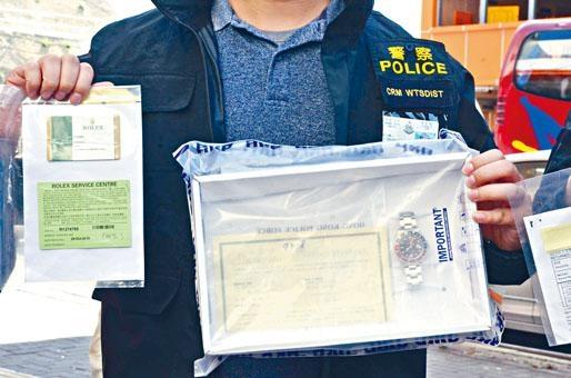 警方展示起回值七萬八千元勞力士名表。